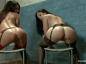 Two gorgeous brunettes are squirting on this sassy milf