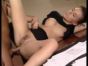 Curly brunette babe gets fucked by her boss in an office