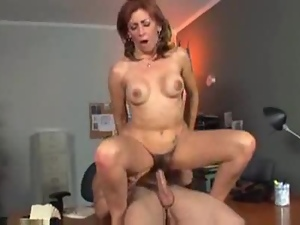 Mature redhead woman gets her hairy pussy drilled