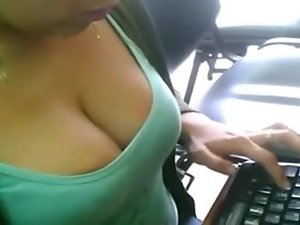 Hot girl with amazing boobs works at the office
