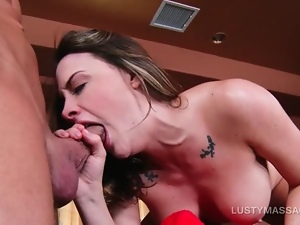 Wild nympho blowing and rubbing masseurs big cock