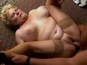 Lewd granny sucks a cock and gets fucked in the hall