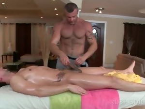 Tattooed gay masseur giving blowjob to his straight client