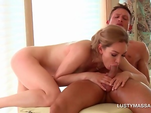 Blonde sex siren riding masseurs dick on his work table
