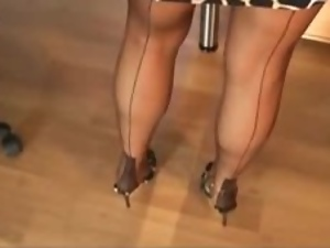 Secretary with beautiful legs gets filmed by a voyeur in the office