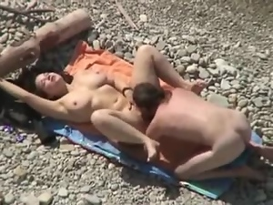 Sexy babe is getting a huge cock of her boyfriend on the beach