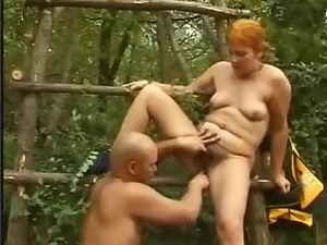 Mature redhead lady gets her cunt pounded in a forest