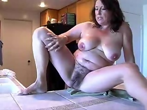 Chubby mature whore plays with her hairy cunt in front of a webcam