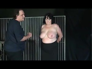 Undressing a fat chick and abusing her tits