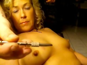 Extreme pain for the flesh of her milf tits