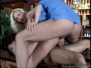 Dicks in her pussy and asshole on the bar