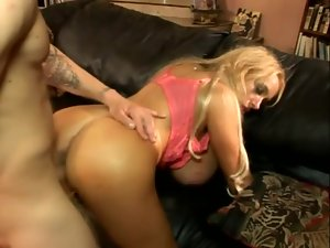 Gigantic fake tits on a blonde milf doing sex