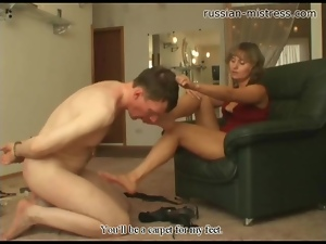 Bound guy licks her feet and gets trampled