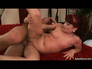 Mature with small firm tits and red hair fucked