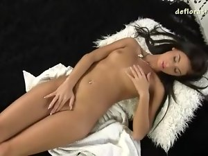 She unfurls her hot body and masturbates solo