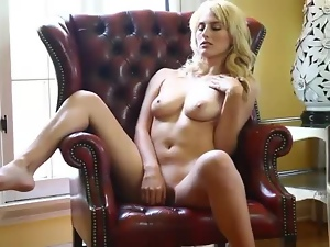 Fit blonde Laura Lovett shows shaved pussy