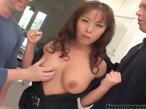 Asian cocksucker on her knees in the kitchen