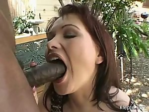 Hot Katja Kassin deepthroating a long thick black pole outside