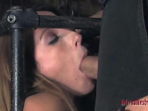 Caged babe forced to give blowjob