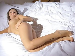Gal plays with long dildo