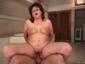 Chubby grandma fucking her young lover