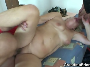Horny grandma takes two dongs