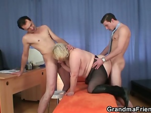 Horny granny fucking two guys