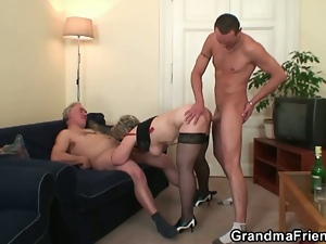 Horny mature takes two cocks