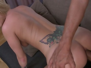 Tattooed blonde receives anal pounding