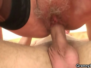 Old bitch rides young cock