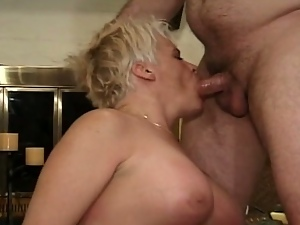 Blonde granny takes multiple cocks deep