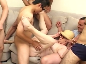 Super horny granny is fucking hard in gangbang