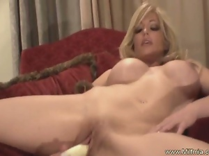 Busty blonde milf squirts on a table