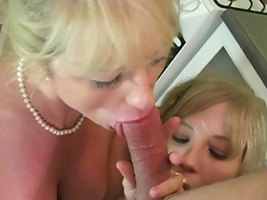 Sexy stepmom teaches stepdaughter how to fuck