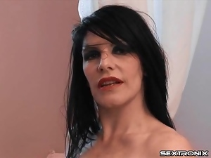 Latex lesbian gets an enema and makes a mess