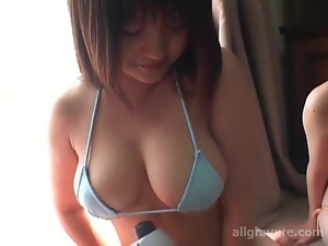 Three cuties in bikinis use vibrating massager