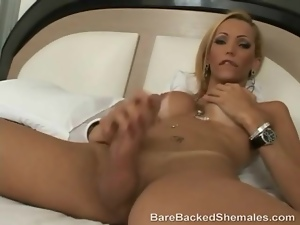 Tall skinny shemale blonde with big tits teases