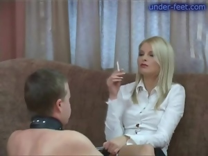 Leashed guy submits to babe in boots