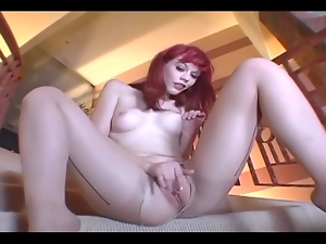 Petite babe masturbating in crotchless hosiery