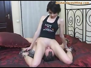 Dark mistress sits over his face and smothers