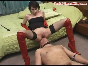 Goddess in leather boots sits on his face