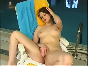 Naked Euro babe with perky tits rubs cunt