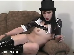 Cute goth babe in top hat teases with a smoke