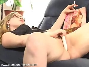 Horny babe with glasses has a smoke then masturbates