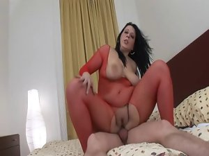 Heavy mummy in red fishnet