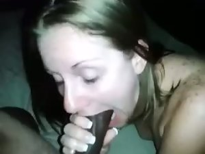Nice looking white female licking her mans BBC