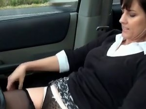 Alluring aged masturbating in her car