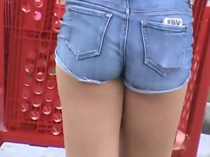Candid Butt in short tense shorts 10