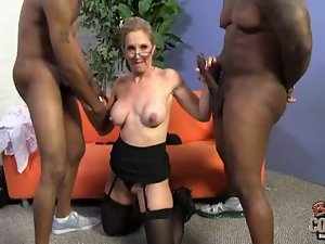 Attractive mature nerdy Stepmom receives two Large dark peckers