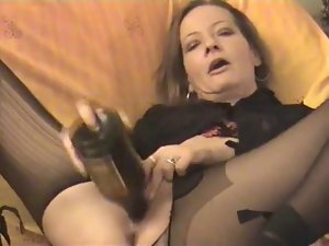 Amateur - attractive Attractive mature twin bottles her snatch & Arse